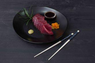 chilled sashimi tuna sliced on plate